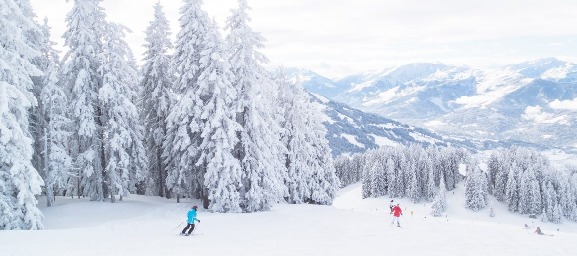 Skiers Exercising On A Mountain