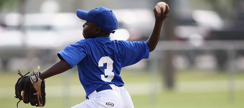 Pitcher Throwing Baseball During Game