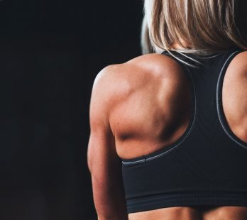 Woman With Healthy & Fit Shoulder Muscles